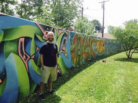 Graffiti growing as an art option columns the journal gazette gazette josh angel 36 co founder of cardinal tattoo piercing coordinated a project to cover a concrete wall on the rivergreenway trail in graffiti altavistaventures Images