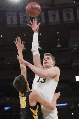 3cd5859d5db Associated Press: Michigan forward Moritz Wagner goes to the basket over  Iowa forward Luka Garza during the first half of an NCAA men's college  basketball ...