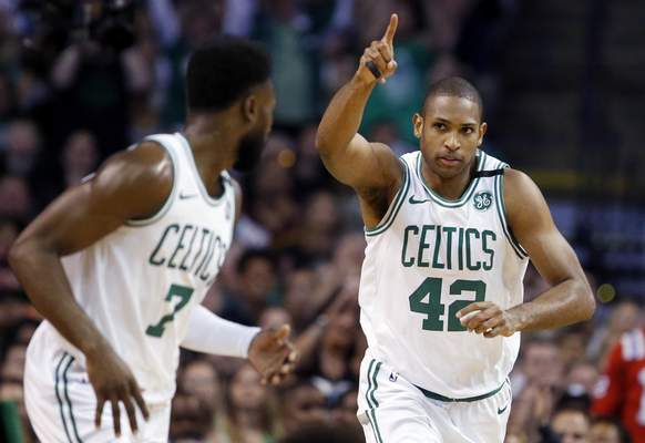 3465d24bc Associated Press Boston Celtics forward Al Horford (42) celebrates a made  basket with guard Jaylen Brown (7) during the first quarter of Game 1 of the  NBA ...