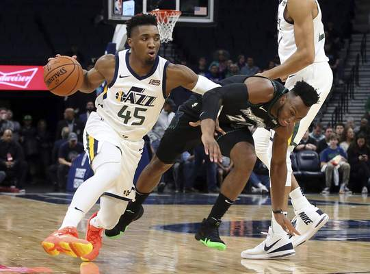 76eb944b Minnesota Timberwolves' Josh Okogie falls as he pursues Utah Jazz's Donovan  Mitchell during the first half of an NBA basketball game Wednesday, Oct.  31, ...