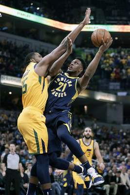 Associated Press Utah Jazz forward Derrick Favors (15) fouls Indiana Pacers  forward Thaddeus Young (21) as he shoots during the first half of an NBA ...