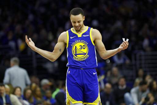 43f003b172c Golden State Warriors  Stephen Curry reacts after a foul was called against  him during the first half of an NBA basketball game against the  Philadelphia ...