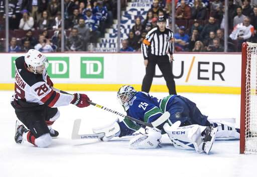 Devils Rally From 2 Goals Down Beat Canucks 3 2 In Shootout Ap
