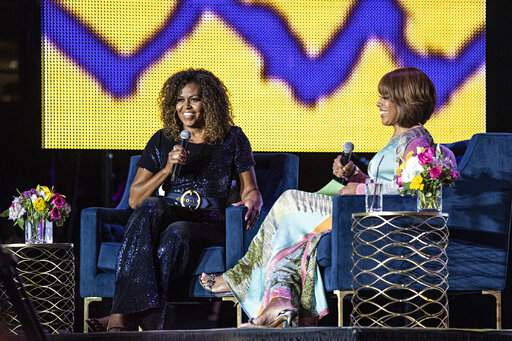 Michelle Obama weighs in on Trump feud with 'the squad' | AP news