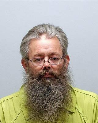 Albion man formally charged with murder and child molesting