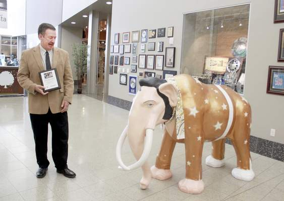 Rachel Von   The Journal GazetteSweetwater founder and president Chuck Surack is surprised by the Bigga Hunka Love mastodon that was sneaked into Sweetwater while he was in a meeting Monday.