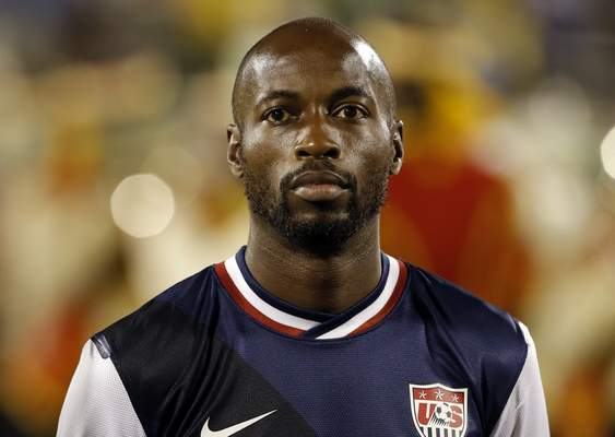 In a June 7, 2013, file photo United States' DaMarcus Beasley listens to the national anthems before the start of the 2014 World Cup qualifying soccer match against Jamaica (AP Photo/Andres Leighton)