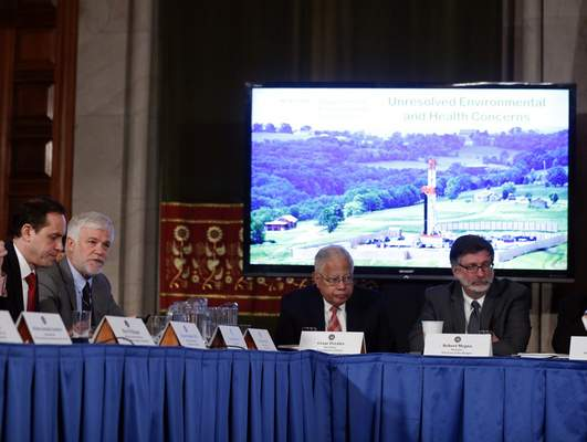 Associated Press New York State Department of Environmental Conservation Commissioner Joseph Martens, second from let, talks on hydraulic fracturing during a cabinet meeting at the Capitol on Wednesday in Albany, N.Y. Gov. Andrew Cuomo's administration will move to prohibit fracking in the state, citing unresolved health issues and dubious economic benefits of the widely used gas-drilling technique.Acting health commissioner Dr. Howard Zucker is seated left.