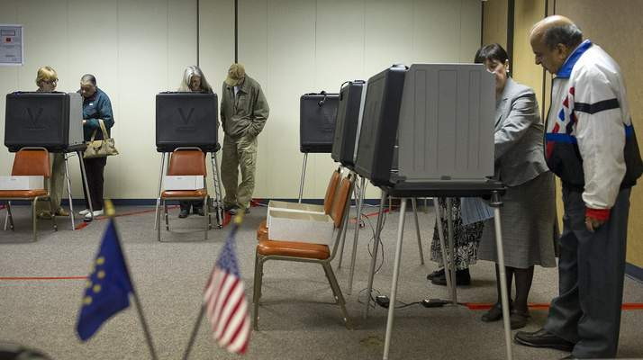 Voters cast their ballots at the Allen County Election Board at 1 West Superior Street Monday morning. Early voting began today and runs thorugh November 2 and housr are Monday through Friday 8:00 AM to 4:30PM. Photo by Swikar Patel.