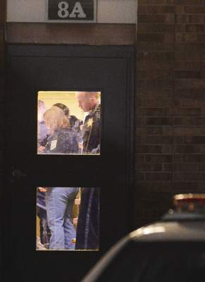 Cathie Rowand | The Journal Gazette Fort Wayne police investigate a shooting inside an apartment on Eden St. Monday.