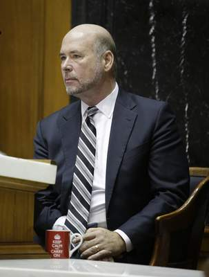 Associated Press Speaker of the House Brian Bosma, R-Indianapolis, listens to a speaker on opening day of the session Tuesday at the Statehouse in Indianapolis.