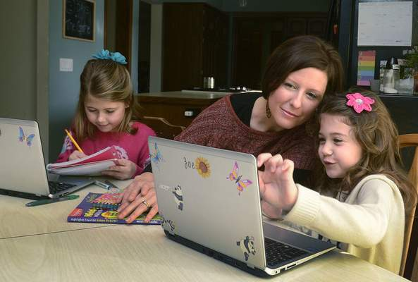 Samuel Hoffman   The Journal Gazette At Premier Medical Home, Amy Heilshorn pays a flat fee for doctor visits for her and daughters Bailey, 8, left, and Zoe, 6.