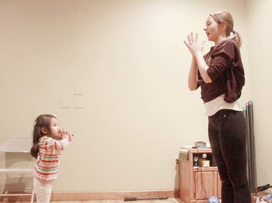 Photos by Rachel Von | The Journal Gazette Amber Pape teaches Kyla De Dios, 4, a yoga position during the kid's yoga class at Pranayoga, 10329 Illinois Road, on Tuesday. Pranayoga offers a variety of yoga classes including a yoga class for kids.