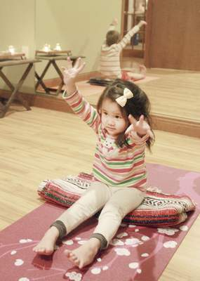 Rachel Von | The Journal Gazette Kyla Ysabel De dios, 3, gets into a yoga position during the kid's yoga class at Pranayoga, 10329 Illinois Road, Fort Wayne, IN on Tuesday. Pranayoga offers a variety of different yoga classes including a yoga class for kids.