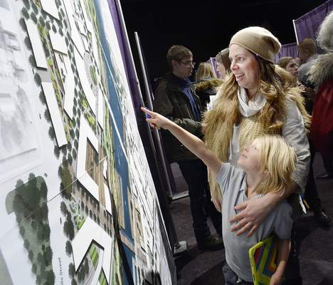 Samuel Hoffman   The Journal Gazette Jennifer Fox and her son Brighton, 6, examine the Promenade Plan, one of the riverfront designs presented Wednesday by SWA Group at Grand Wayne Center.