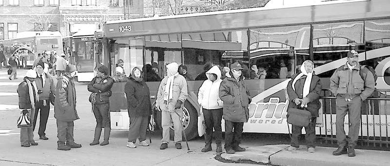 Passengers wait for buses at Citilink's transfer station on Superior Street, Thursday. Citilink is reporting slightly increased ridership this year.