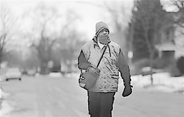 James Robertson, 56, of Detroit, walks to catch his morning bus as a part of his commute to work on Jan. 29, 2015. Hundreds of people have contributed tens of thousands of dollars to help Robertson, who says he typically walks 21 miles (34 kilometers) to get to and from work. Robertson began making the daily trek to the factory where he molds parts after his car stopped working ten years ago and bus service was cut back. He's had perfect attendance for more than 12 years. (AP Photo/Detroit Free Press, Ryan Garza)  DETROIT NEWS OUT; TV OUT; MAGS OUT; NO SALES; MANDATORY CREDIT DETROIT FREE PRESS