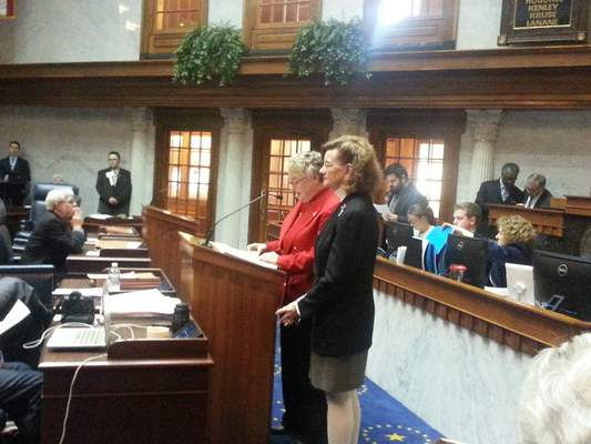 Sen. Sue Glick, R-LaGrange, welcomes IPFW Chancellor Vicky Carwein Thursday during a resolution to honor the campus' 50th Anniversary