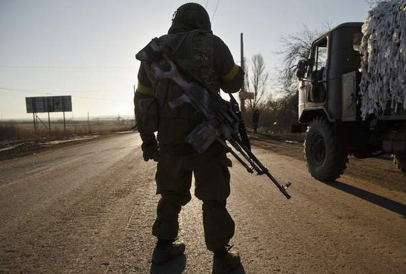 Associated Press A Ukrainian serviceman stands on the road in the wake of last week's battle for the nation's Debaltseve region. Though students at northeast Indiana universities are far removed from the events halfway around the world, they appreciate the globe's interconnectedness and study accordingly, professors say.