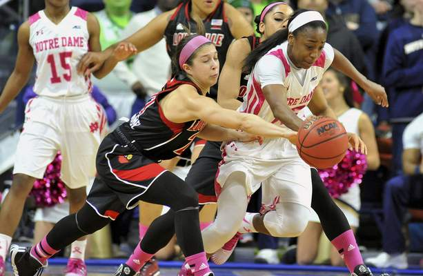 Associated Press photos Notre Dame guard Jewell Loyd, who scored 20 points, and Louisville guard Jude Schimmel battle for a loose ball in the first half Monday night in South Bend.
