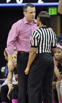 Louisville coach Jeff Walz disagrees with referee Carla Fountain after Walz receives a technical foul.