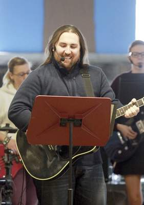 Rachel Von | The Journal Gazette Mike Walter leads a Genesis gathering at Aldersgate United Methodist Church, 2417 Getz Road. The nontraditional services include music and special lighting.