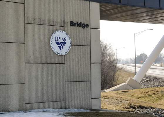 Michelle Davies   The Journal Gazette The Willis name was removed recently from the pedestrian bridge across Crescent Avenue serving IPFW students.