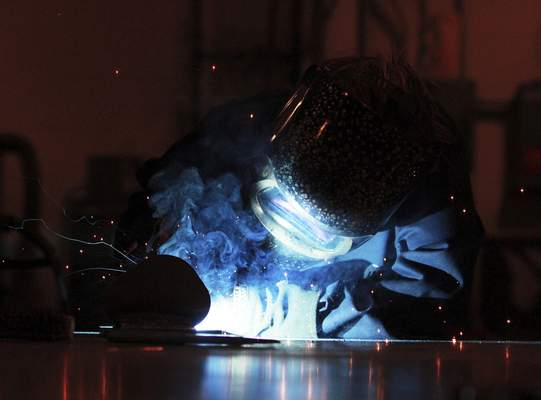Photos by Rachel Von | The Journal Gazette Amy Kelham, of Auburn, welds during her independent study time at Ivy Tech Community College Northeast in Fort Wayne. Kelham, 33, is pursuing an associate degree in industrial technology with a concentration in welding.