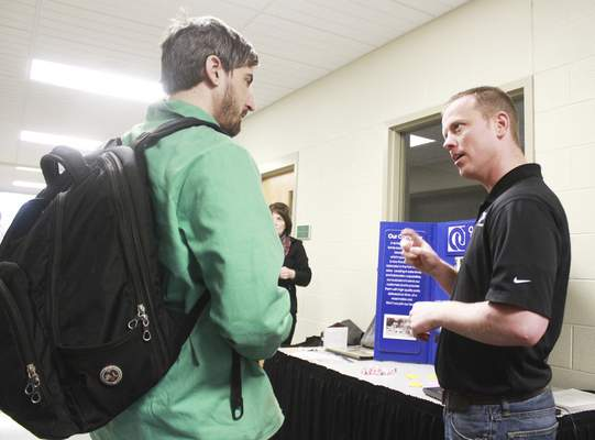 Rachel Von | The Journal Gazette Ottenweller's Richard May, right, talks with Ivy Tech student Matthew Vance during a welding conference at Ivy Tech Community College-Northeast in the Keith Busse Technology Center on Tuesday. The conference included many companies who are in need of trained welders.