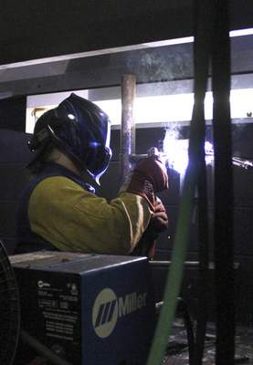 Rachel Von | The Journal Gazette Ivy Tech student Austin Parker practices welding in a welding booth during class at Ivy Tech Community College on a recent Monday.