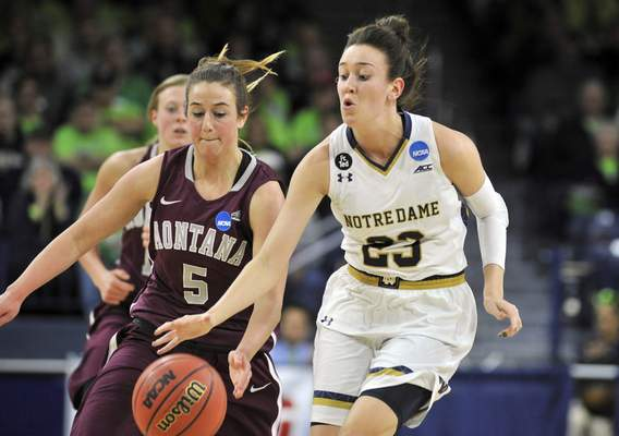 Associated Press Notre Dame guard Michaela Mabrey (23) dribbles past Montana guard McCalle Feller (5) in the first half of an NCAA tournament college basketball first round game Friday in South Bend.