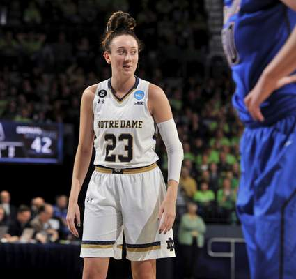 Associated Press Notre Dame guard Michaela Mabrey (23) looks over to her bench after making a shot in the second half of an NCAA college basketball game against DePaul in the second round of the NCAA women's tournament in South Bend Sunday.