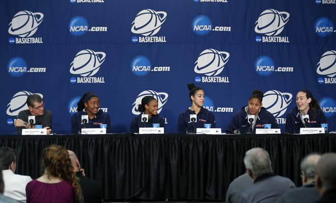 Connecticut head coach Geno Auriemma, left, and players Morgan Tuck, Moriah Jefferson, Kia Nurse, Kaleena Mosqueda-Lewis and Breanna Stewart answer questions during a news conference for a women's college basketball regional final game in the NCAA Tournament on Sunday, March 29, 2015, in Albany, N.Y. UConn plays Dayton on Monday. (AP Photo/Mike Groll)
