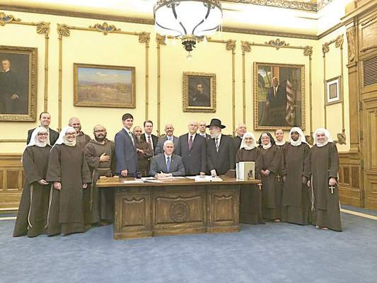 Photo released by Gov. Mike Pence's office on the signing of Senate Bill 101