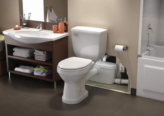 Courtesy Macerating toilets use an electric pump to send waste to existing pipes, eliminating the need for additional plumbing.