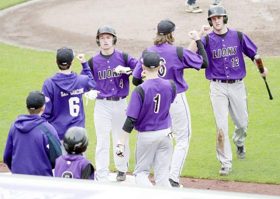 Rachel Von | The Journal Gazette Leo teammates celebrate with Gunner Brown (4) and Jordan Hissong (12) during Monday's 9-4 win over Norwell at Parkview Field. The high school teams played at Parkview as part of the Parkview Sports Medicine High School Baseball Series.