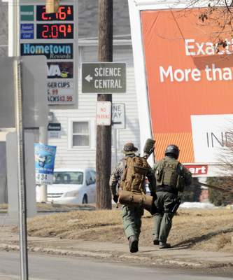 Chad Ryan | The Journal Gazette File photo: Members of the Fort Wayne Police Department's Emergency Services Team travel west on State Blvd. as they head to the scene of a possible standoff on Clinton Street.