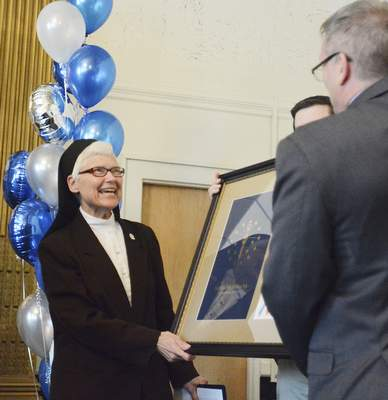 Cathie Rowand   The Journal GazetteSt Francis University president Sisiter M. Elise Kriss receives the Sagamore of the Wabash during USF renovation celebration to kickoff their downtown campus project.