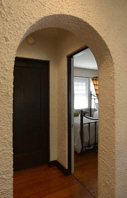 Samuel Hoffman | The Journal Gazette Who Lives There: arched doorway at the home of Quinn and Jody Hirschy.