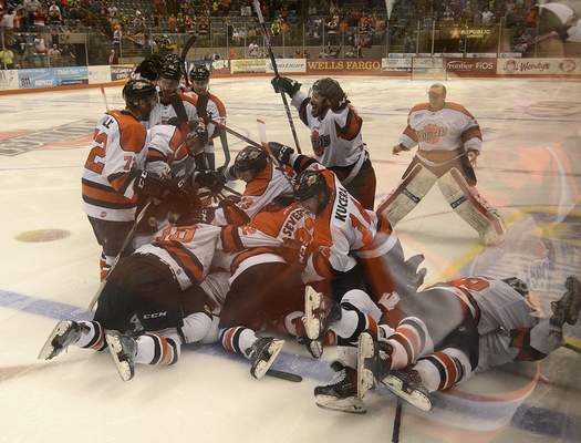 Samuel Hoffman | The Journal Gazette The Komets celebrate what they thought was a game-winning goal by Matthew Pistilli against Toledo, 2nd overtime period, Sunday. Pistilli's goal was waived off but teammate Brett Perlini won the game for real moments later.