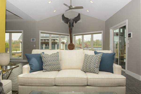 Michelle Davies | The Journal Gazette The living room of the CDI Innovation home features blues, earth themes and lots of different textures.