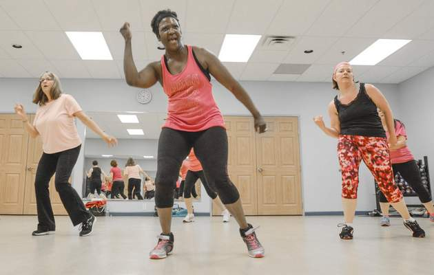 Michelle Davies | The Journal Gazette Coaxed by her daughter to learn Zumba about 10 years ago, Sarah Hudson teaches a class three nights a week at different locations.