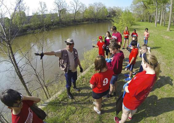 Chad Ryan | The Journal Gazette Matt Jones of the Allen County Partnership for Water Quality explains facts about the St. Joseph River to Canterbury Middle School students, who cleaned up areas of Johnny Appleseed Park and the riverbank.