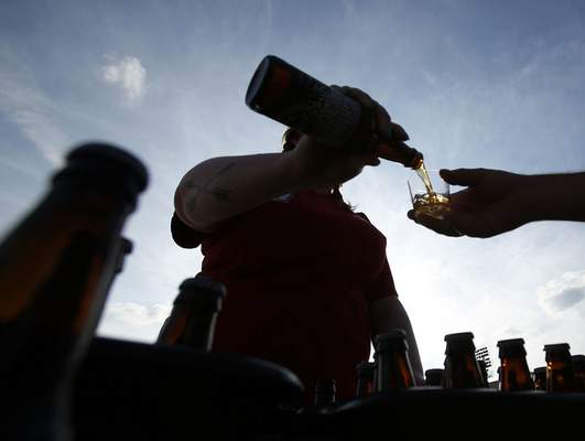 Photos by Chad Ryan | The Journal Gazette Izzy Sherman pours a 2XIPA from Southern Tier Brewing during the Rock n' Brew fest Saturday at Parkview Field.