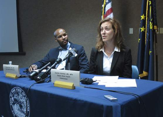 Associated Press Indiana's deputy state health Commissioner Jennifer Walthall speaks Wednesday during a news conference with State Health Commissioner Dr. Jerome Adams on an HIV outbreak in southeastern Indiana. Adams and Walthall announced that a community outreach center in Austin, the Scott County city that's the outbreak's epicenter, will close next week and reopen at another location that will remain in operation for at least one year. Indiana's outbreak tied to needle-sharing among intravenous drug users has 169 confirmed HIV cases and one preliminary positive case.