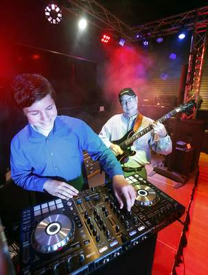 Chad Ryan | The Journal Gazette Benny Bergle – aka DJ Benny Bergle – and his father, Kenny, will mark Father's Day on Sunday by working together at Make Music Day, mixing jazz and electronic music as one of 18 acts at Friemann Square downtown.
