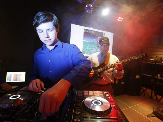 Chad Ryan | The Journal Gazette DJ Benny Bergle, left, and his father, Kenny Bergle will be working together during Make Music Day on Father's Day when the duo will go back and forth from playing jazz to mixing dubstep and hip hop.