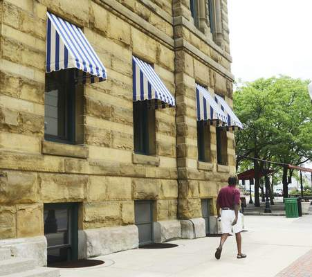 Cathie Rowand | The Journal Gazette The History Center has new awnings, restoring it to its appearance at the turn of the century, thanks to a scrap of cloth discovered during renovations.