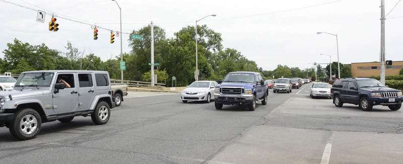 Michelle Davies   The Journal Gazette Traffic flows along Spy Run Avenue and State Boulevard at 5 p.m. during a recent afternoon rush hour.