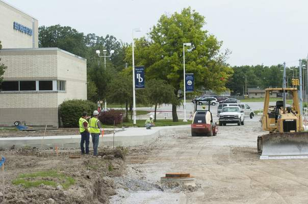 Subcontractors do site work Thursday for a new chapel at Bishop Dwenger High School.